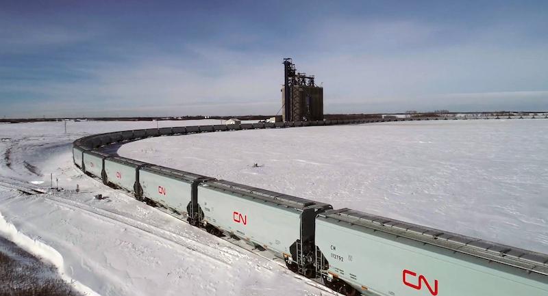 CN Grain cars pulling through filling station